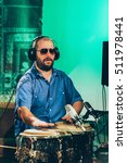 percussionist playing drums on... | Shutterstock . vector #511978441