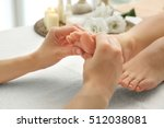 foot massage in spa salon ... | Shutterstock . vector #512038081