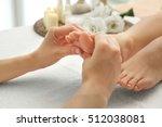 foot massage in spa salon ... | Shutterstock . vector #512038081
