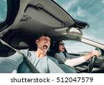 screaming couple riding in car... | Shutterstock . vector #512047579