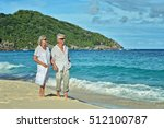 Elderly Couple Rest At Tropica...