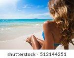 woman in bikini sitting on the... | Shutterstock . vector #512144251