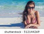 Young Woman In Bikini Laying B...