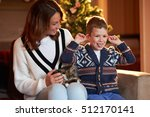 a mother with her little son... | Shutterstock . vector #512170141