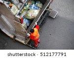 garbage man at work on the...