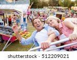 senior couple on a ride in... | Shutterstock . vector #512209021