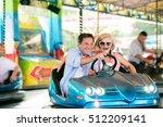 Senior Couple In The Bumper Ca...