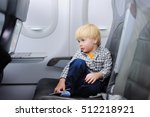 cute little boy traveling by an ...   Shutterstock . vector #512218921