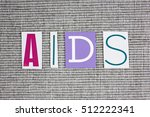 Small photo of AIDS (Acquired Immune Deficiency Syndrome) acronym on grey background