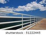 Railing On Boardwalk With Blue...
