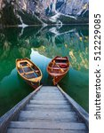 boats on the braies lake  ... | Shutterstock . vector #512229085