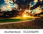 green field and beautiful sunset | Shutterstock . vector #512246695