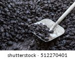 Small photo of Shovel and coal in the background coal mine