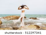 sexy lady stand on rock in... | Shutterstock . vector #512297341