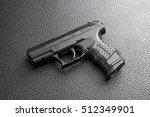 black pistol on black table | Shutterstock . vector #512349901