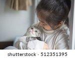 Stock photo happy little asian girl cuddle lovely scottish fold kitten 512351395