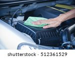 wipe cleaning the car engine... | Shutterstock . vector #512361529
