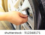 hand removing a tire black.... | Shutterstock . vector #512368171