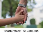 mother and a child holding... | Shutterstock . vector #512381605