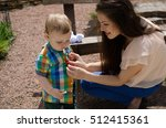 young mother changes clothes... | Shutterstock . vector #512415361