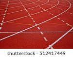 Small photo of all-weather running track, rubberized artificial racing lane surface for track and field athletics, texture of white lines and curved in the stadium