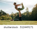 fit young couple doing acro... | Shutterstock . vector #512449171