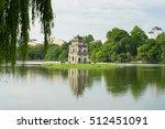 Hoan Kiem lake (Sword lake, Ho Guom) in Hanoi, Vietnam with willow branches on foreground