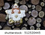 Small photo of Minimalist Christmas sweet golden angel decoration on rustic firewood slew background