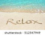relax handwritten on sandy... | Shutterstock . vector #512547949