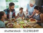 elderly woman serving meal to... | Shutterstock . vector #512581849