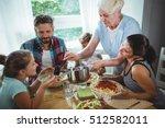 elderly woman serving meal to...   Shutterstock . vector #512582011