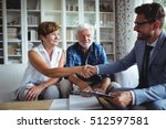 financial advisor shaking hands ... | Shutterstock . vector #512597581