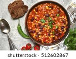 chili con carne in a clay bowl... | Shutterstock . vector #512602867