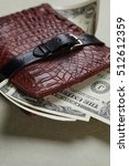 wallet with money | Shutterstock . vector #512612359