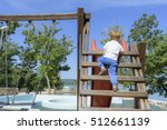 Little Boy Climbing Ladder On...