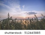 beautiful sunset over lake  | Shutterstock . vector #512665885