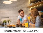 happy couple enjoying breakfast ... | Shutterstock . vector #512666197