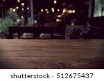 Stock photo top of empty wood table with bar cafe restaurant blurred background product display template 512675437