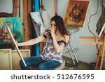woman artist painting a picture ... | Shutterstock . vector #512676595