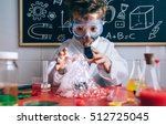 happy kid making experiments... | Shutterstock . vector #512725045