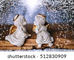 two angel sitting on a piece of ... | Shutterstock . vector #512830909
