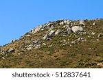 a rocky rolling green hill.   Shutterstock . vector #512837641
