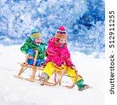 little girl and boy enjoy a... | Shutterstock . vector #512911255