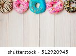 colorful donuts on wooden... | Shutterstock . vector #512920945