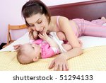 mother plays with babygirl on... | Shutterstock . vector #51294133
