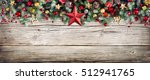 Small photo of Christmas Header - Border Of Fir Branches And Baubles On Old Wood