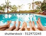 family relaxing near swimming... | Shutterstock . vector #512972245