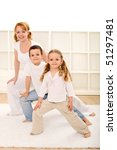 Happy kids and woman doing some gymnastic exercises indoors - stock photo