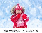 baby playing with snow in... | Shutterstock . vector #513033625