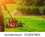 lawn mower cutting green grass... | Shutterstock . vector #513037801